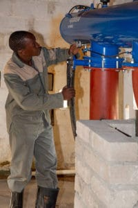 Cyril Maseko, who was accepted into the class of 2019 at Recruitagri, gets hands-on experience in a pumphouse.