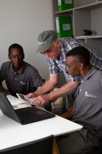 Roy Porritt, who was commissioned to develop the course content, discusses water infiltration with Cyril Maseko, left, and Xolani Msithini.