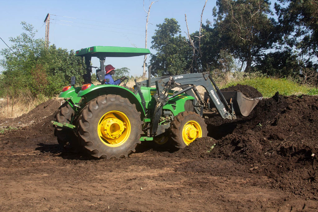 Once the wood chips have broken down into compost, it is loaded up and taken for spreading in the orchards.